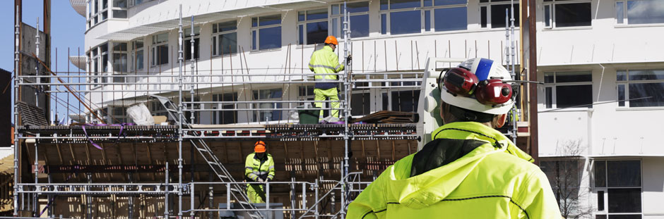 Scaffolding photo showing scaffolders working on building wearing safety clothing